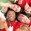 Stock Photo: Portuguese football fans reaching out
