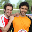 Three young football players on a football field. — Stock Photo