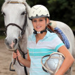 Girl with white horse — Stock Photo