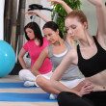 Female threesome doing exercise indoors — Stock Photo