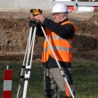 Man surveying site - Stock Photo