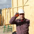 Craftsman building a wooden house — Stock Photo