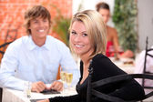 Happy couple at restaurant — Stock Photo