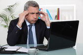 Man stressed with a laptop — Stock Photo
