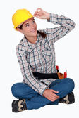 Tradeswoman touching the brim of her hat — Stock Photo