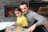 Young girl playing a game with her father — Stock Photo
