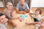 Family playing board games. — Stock Photo
