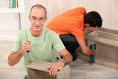 Father and son building furniture — Stock Photo