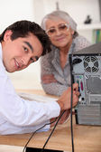 Young man repairing a computer — Stock Photo