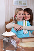 Mother and daughter baking together — Stock Photo