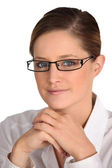 Portrait of brunette wearing glasses — Stock Photo