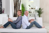Couple each working on their own laptop — Stock Photo