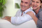 Middle-aged couple at home — Stock Photo