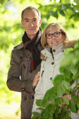 Senior couple walking in the forest — Stock Photo