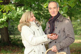 Couple gathering conkers — Stock Photo