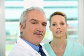Friendly looking doctor and nurse — Stock Photo