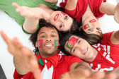 Portuguese football fans reaching out — Stock Photo