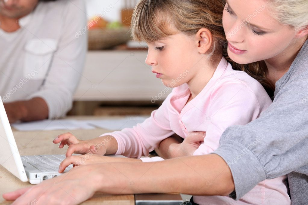Young mother teaching her daughter how to use computer — Stock Photo #7662694