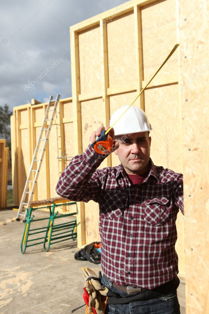 Craftsman building a wooden house — Stock Photo #7665291