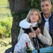 Couple on a romantic picnic in a vineyard — Stock Photo