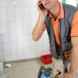 Plumber using a cellphone — Stock Photo