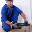 Stock Photo: Plumber drilling