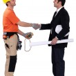 Architect and electrician shaking hands — Stock Photo #7673669