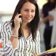 Royalty-Free Stock Photo: Woman on the phone holding office files