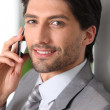 Businessman making call using mobile telephone — Stock Photo