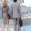 Man and woman at the airport - Stock Photo