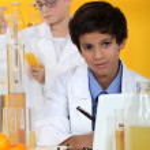 Little boy in chemistry class — Stock Photo