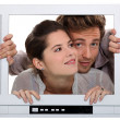 Couple inside a television set - Stock Photo