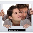 Couple inside television set — Stock Photo #7675259