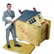 Architect stood with model house in background — Stock Photo