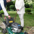 Stock Photo: Senior with gardener and lawnmower