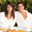 Young couple having breakfast outside - Stockfoto