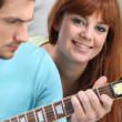 Youngster playing the guitar — Stock Photo