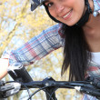 Woman riding her bike — Stock Photo #7676419