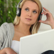 Young woman listening to music — Stock Photo #7676431