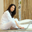 Royalty-Free Stock Photo: Brunette working on laptop in Zen atmosphere