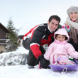 Family on winter holiday — ストック写真