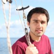 Young man on sailing boat offshore — Stock Photo