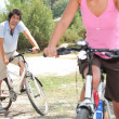Couple riding bikes in the countryside — Stock Photo #7676922