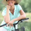 Woman riding bike — Stock Photo