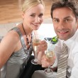 Couple drinking champagne — Stock Photo