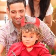 Portrait of a little girl and parents — Stock Photo #7677378
