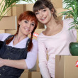 Young women moving into their new apartment — Stock Photo
