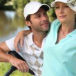 Golfer couple — Stock Photo