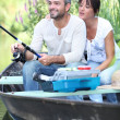 A couple fishing on a boat — Stock Photo