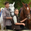 Young horseriding - Stock Photo